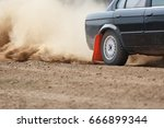 rally car turning in dirt track ... | Shutterstock . vector #666899344