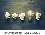 light bulb glowing in a row of...   Shutterstock . vector #666928378