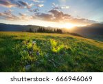 sunset in the mountain valley.... | Shutterstock . vector #666946069