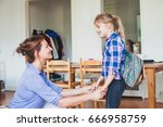 mother talking with daughter at ... | Shutterstock . vector #666958759