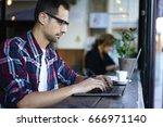 pensive male freelancer in... | Shutterstock . vector #666971140