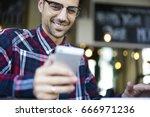 smiling handsome hipster guy... | Shutterstock . vector #666971236