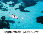 aerial view of a sail boat in... | Shutterstock . vector #666973399