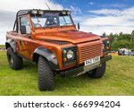 TAIN, SCOTLAND - JUNE 18 2017: Land Rover Defender parked on grass - stock photo