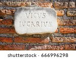 Small photo of Vicus Iugarius sign on the brick wall in Rome, Italy