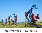 oil pump jacks working at dawn. | Shutterstock . vector #66700885