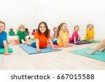 kids stretching backs on yoga... | Shutterstock . vector #667015588