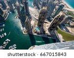 dubai skyscrapers from above.... | Shutterstock . vector #667015843