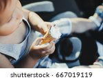 a small child eating ice cream  ... | Shutterstock . vector #667019119