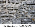 antique natural stonewall | Shutterstock . vector #667024300