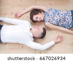 happy young couple lying... | Shutterstock . vector #667026934
