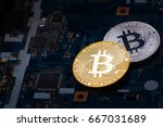golden and silver bitcoins on a ... | Shutterstock . vector #667031689