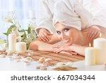 young woman having massage | Shutterstock . vector #667034344