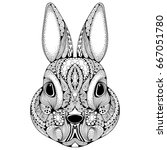Stock vector hand drawn graphic ornate head of rabbit with ethnic floral doodle pattern vector illustration for 667051780