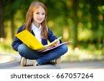 adorable little schoolgirl... | Shutterstock . vector #667057264