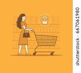 woman with shopping cart in a... | Shutterstock .eps vector #667061980