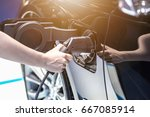 electric vehicle charging... | Shutterstock . vector #667085914