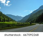 long road with mountains in... | Shutterstock . vector #667092268