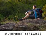 hiker man takes a rest during... | Shutterstock . vector #667113688