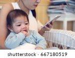 cute baby boy sucking finger ... | Shutterstock . vector #667180519