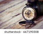 vintage pocket watch on wood... | Shutterstock . vector #667190308