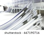 stacks of paper in office | Shutterstock . vector #667190716