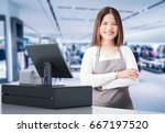 asian worker with cashier desk... | Shutterstock . vector #667197520