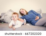 baby playing while mother is... | Shutterstock . vector #667202320