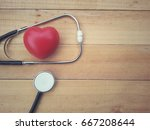 red heart and stethoscope on