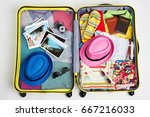 yellow suitcase packed with... | Shutterstock . vector #667216033