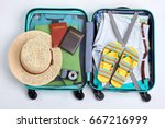 beach accessories in opened... | Shutterstock . vector #667216999