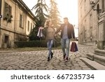 couple in shopping together.... | Shutterstock . vector #667235734