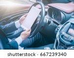 businessman sit in his car... | Shutterstock . vector #667239340