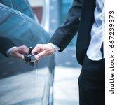 hand of businessman opening... | Shutterstock . vector #667239373