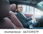 businessman sit in his car... | Shutterstock . vector #667239379