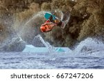 man makes an extreme jump on... | Shutterstock . vector #667247206