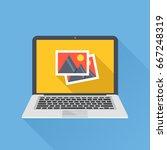 photos icon on laptop screen.... | Shutterstock .eps vector #667248319