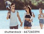 happy interracial couple... | Shutterstock . vector #667260394