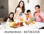 happy indian asian young family ... | Shutterstock . vector #667261318