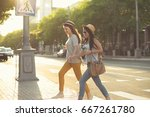 female couple walking after... | Shutterstock . vector #667261780