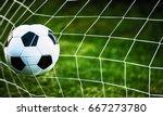soccer ball in goal on green... | Shutterstock . vector #667273780