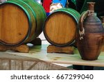 a jug and a barrel of wine | Shutterstock . vector #667299040