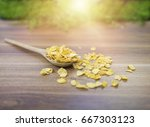 corn flakes on wood table | Shutterstock . vector #667303123
