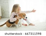 child with dog | Shutterstock . vector #667311598