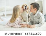 Stock photo child with dog 667311670