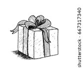 hand drawn gift box with bow.... | Shutterstock . vector #667317340