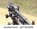 """Small photo of Shallow focus shot of an L7A2 GPMG """"GIMPY"""" General Purpose Machine Gun mounted on tripod"""