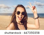 happy young girl in sunglasses... | Shutterstock . vector #667350358