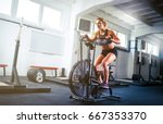 woman at the gym using exercise ... | Shutterstock . vector #667353370