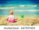baby girl playing in the sand... | Shutterstock . vector #667357603